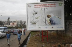 children in front of ebola billboard